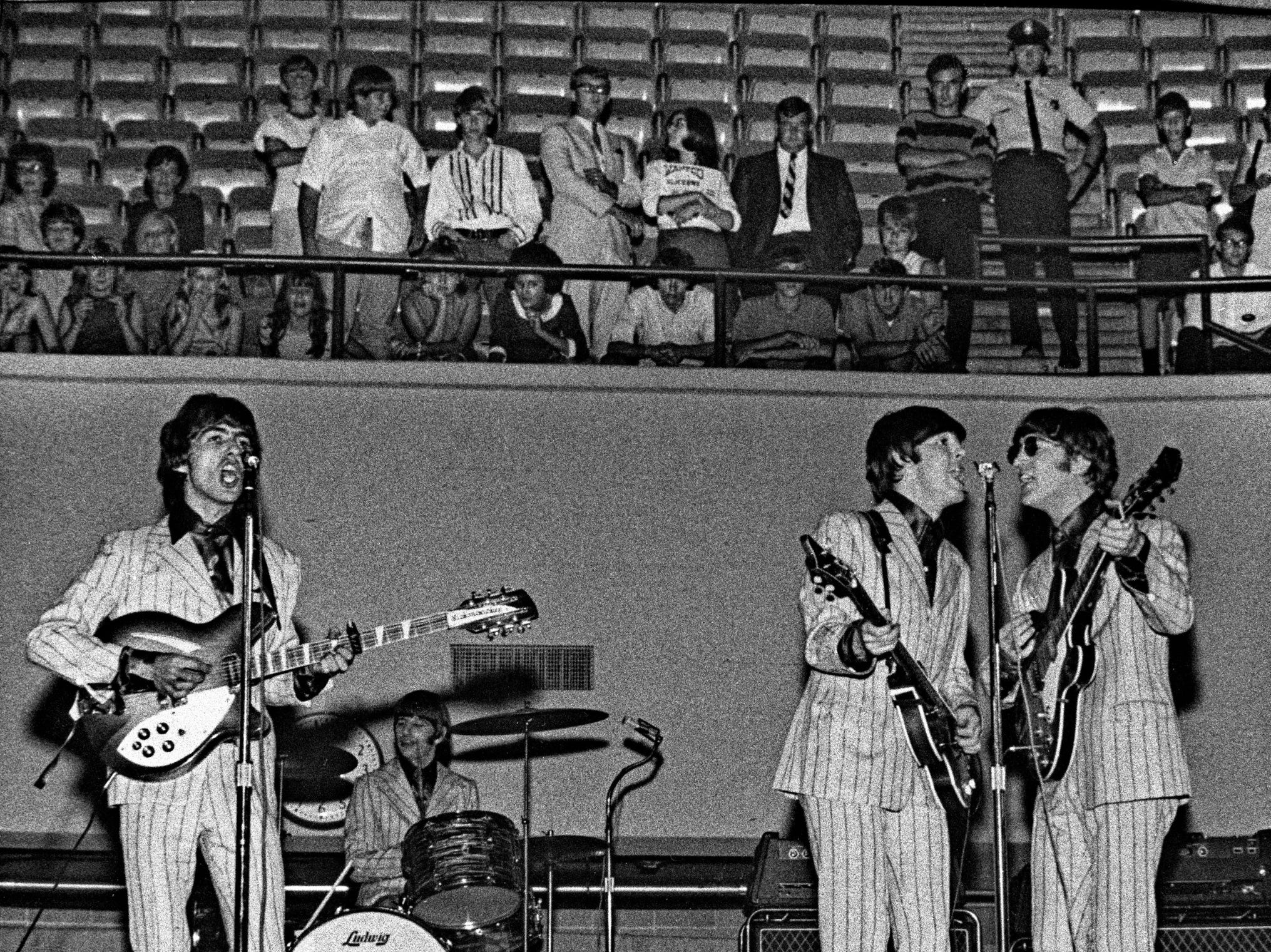 "The Beatles performed at 4 and 8:30 p.m. at the Mid-South Coliseum in Memphis, Friday, August 19, 1966. The Commercial Appeal reported that 20,128 people ""heard the Liverpudlians bow to Dixie."" A total of 7,589 attended the afternoon show and 12,539 showed up at the evening concert. The Cyrkle, Bobby Hebb, The Ronettes and The Remains also were on the bill. Tickets cost $5.50. According to the newspaper, the Beatles - John Lennon, Paul McCartney, George Harrison and Ringo Starr - wore ""modish-dull gray suits"" for the afternoon show and ""dark green creations with chartreuse shirts"" for the evening concert. A chain link fence surrounded the stage. Across town, a crowd of more than 8,000 filled the Auditorium North Hall and part of the South Hall for the Memphis Christian Youth Rally. This was provoked by Lennon's statement that the Beatles were more popular than Jesus Christ. ( By Robert Williams / The Commercial Appeal)"
