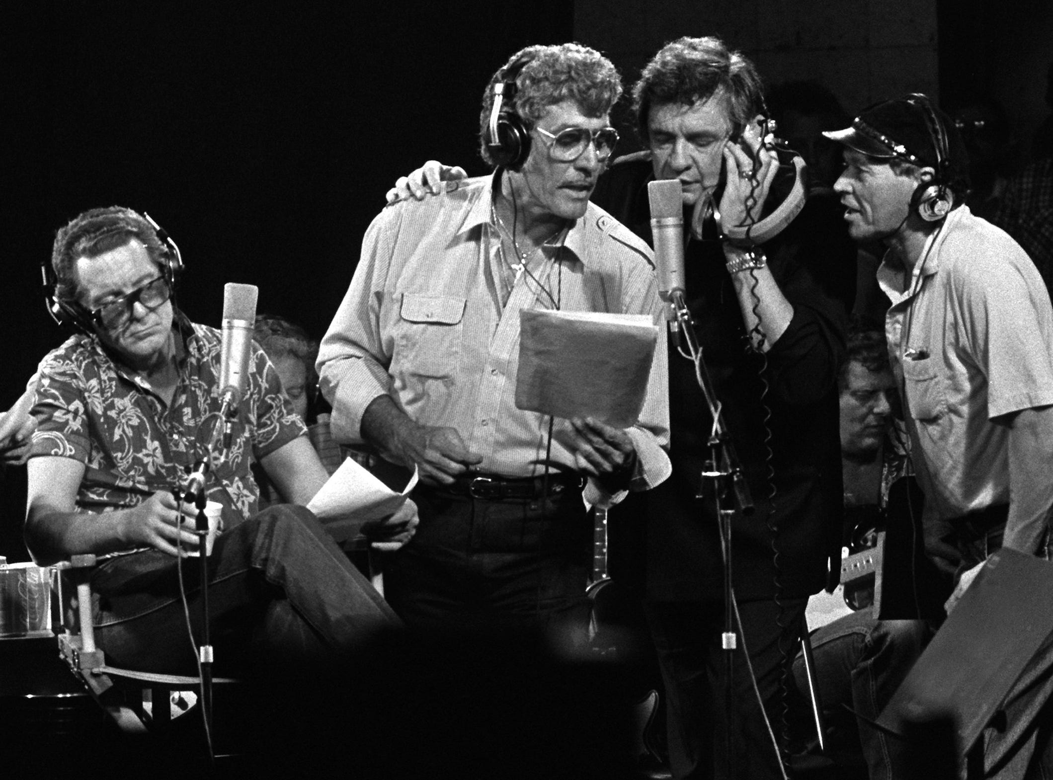 "LEFT to RIGHT:  Roy Orbison, Jerry Lee Lewis, Carl Perkins, Johnny Cash and producer Chips Moman sing during the recording of the ""Class Of 55"" on September 20, 1985.  Moman recorded the reunion album using the four legnedary rock 'n rollers that got their starts in Memphis.  The face between Cash and Moman is lead guitar player Reggie Young.  This scene took place at Moman's old American Recording Studio on North Thomas.  Copyright Dave Darnell / 1985."