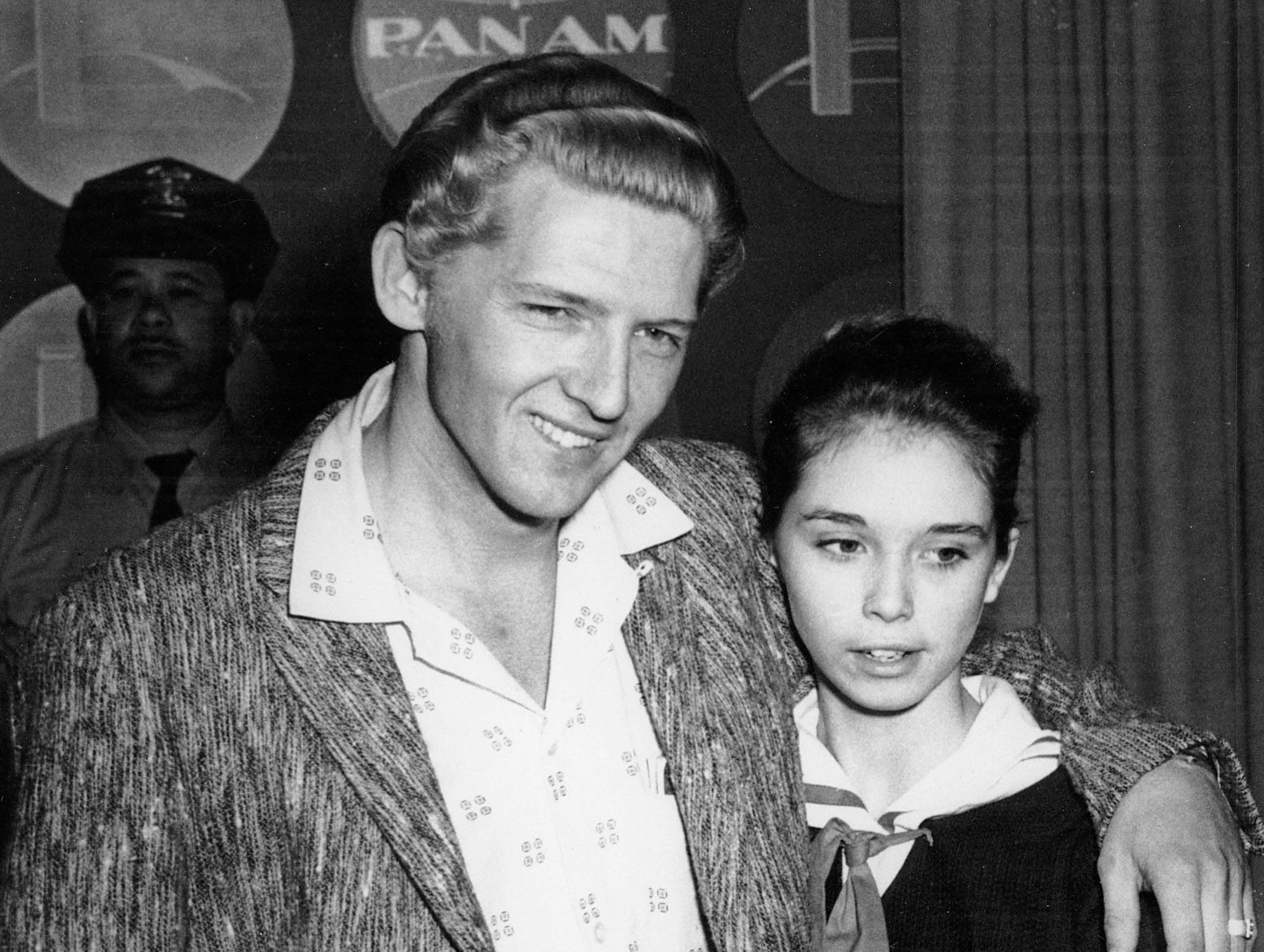 Seen at a London press conference on May 24, 1958 are American Rock 'n' Roll singer Jerry Lee Lewis, 22, and his cousin, Myra Brown, 13, whom he took as his third wife before divorcing his second.  (AP Photo)