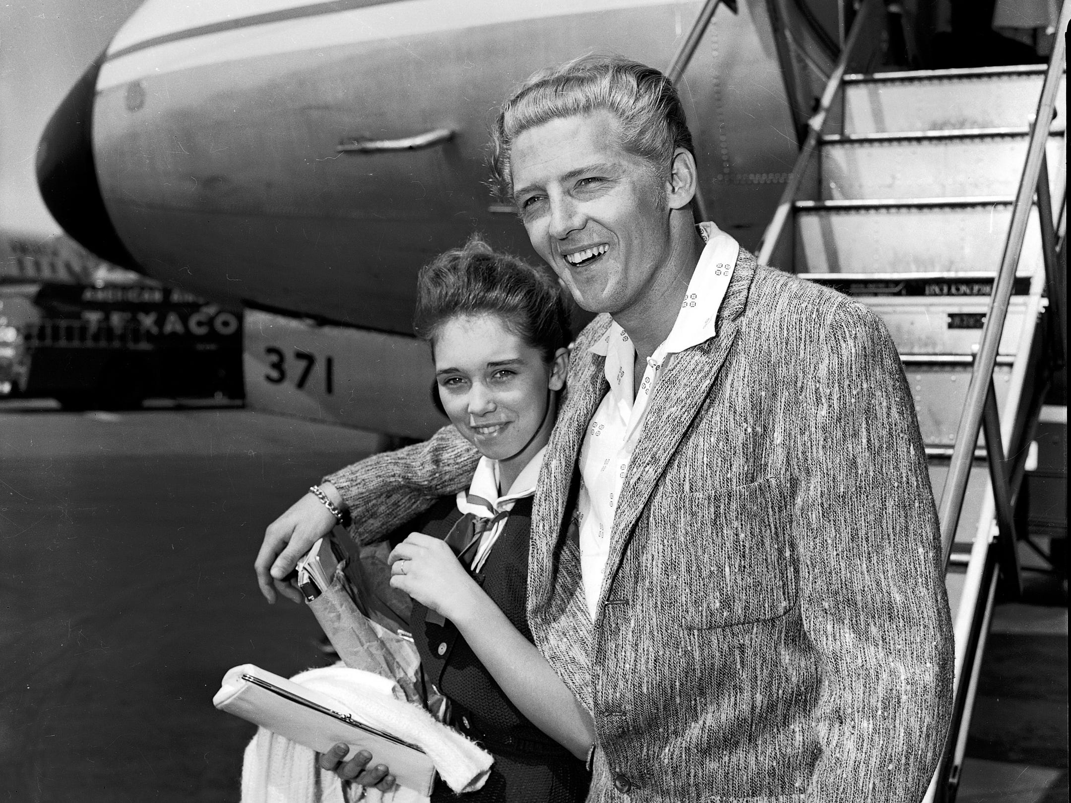 May 27, 1958 - Jerry Lee Lewis and wife Myra return from a rough stay in London on May 27, 1958.  The beleaguered Lewis arrived home tired and confused about the trouble caused by the revelation of his five-month marriage to London reporters. The rock and roll singer and his 13-year-old bride went to their home at 4752 Dianne to rest from their long trip to London. (Lloyd Dinkins/The Commercial Appeal files)