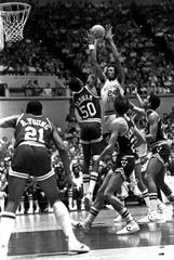 Memphis State All-American Keith Lee (24) shoots over Virginia Tech defender Calvin Oldham (50) on Jan. 30, 1982.
