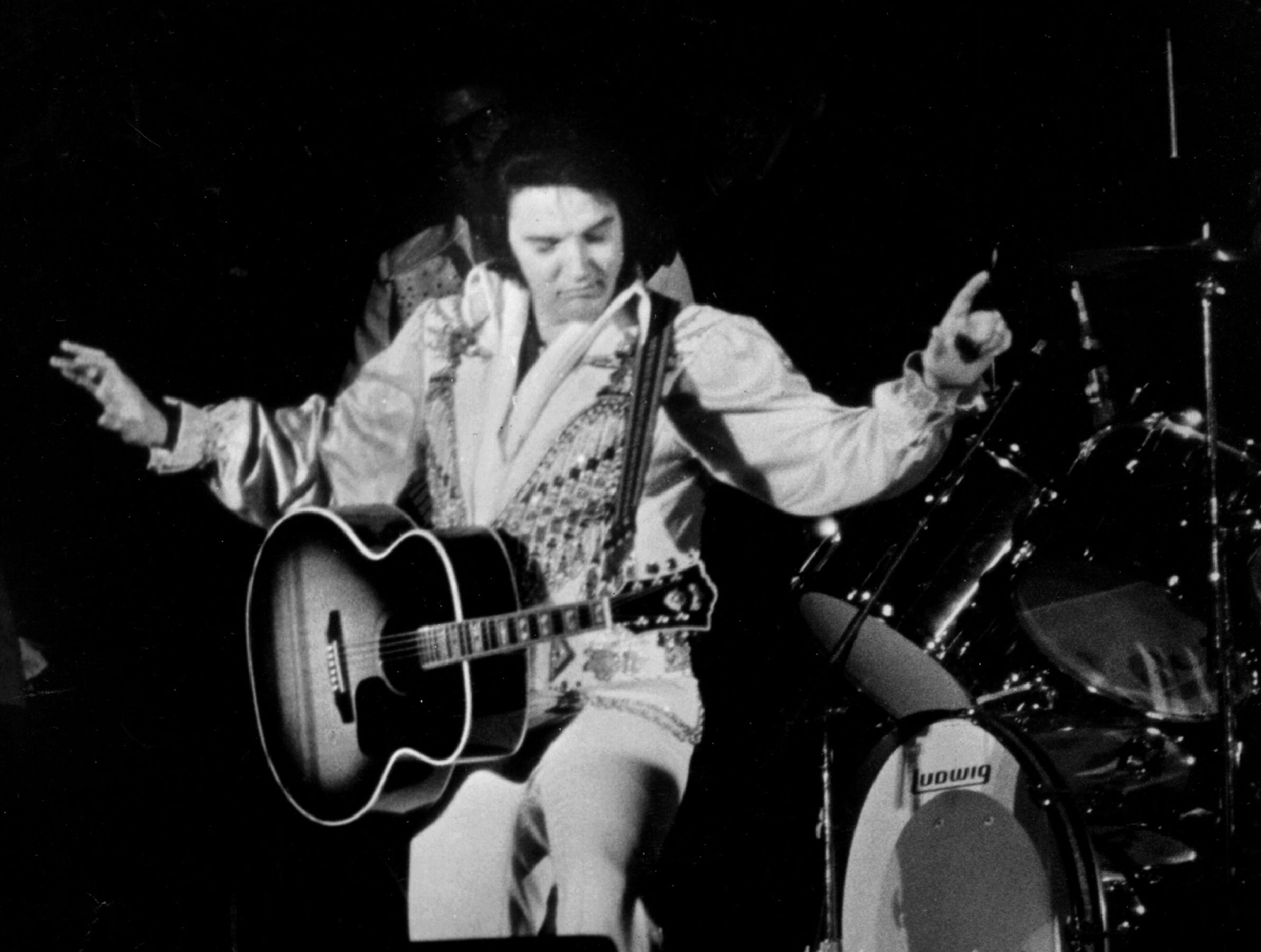 "July 5, 1976 - Elvis Presley performs what would be his last Memphis concert July 5, 1976 before a crowd of 12,000 at Mid-South Coliseum. Exactly twenty-two years earlier (7/5/54), Elvis recorded ""That's All Right"" at Sam Phillips' little studio at 706 Union. Introducing the song, he said: ""I've had some people say - well, you can't do that song anymore - well, you, by God, just watch me."" (By Barney Sellers/ The Commercial Appeal)"