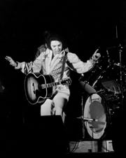 "Elvis Presley performs at his last Memphis concert July 5, 1976, before a crowd of 12,000 at Mid-South Coliseum. Exactly 22 years earlier, Elvis recorded ""That's All Right"" at Sam Phillips' little studio at 706 Union. Introducing the song, he said: ""I've had some people say - well, you can't do that song anymore - well, you, by God, just watch me."""