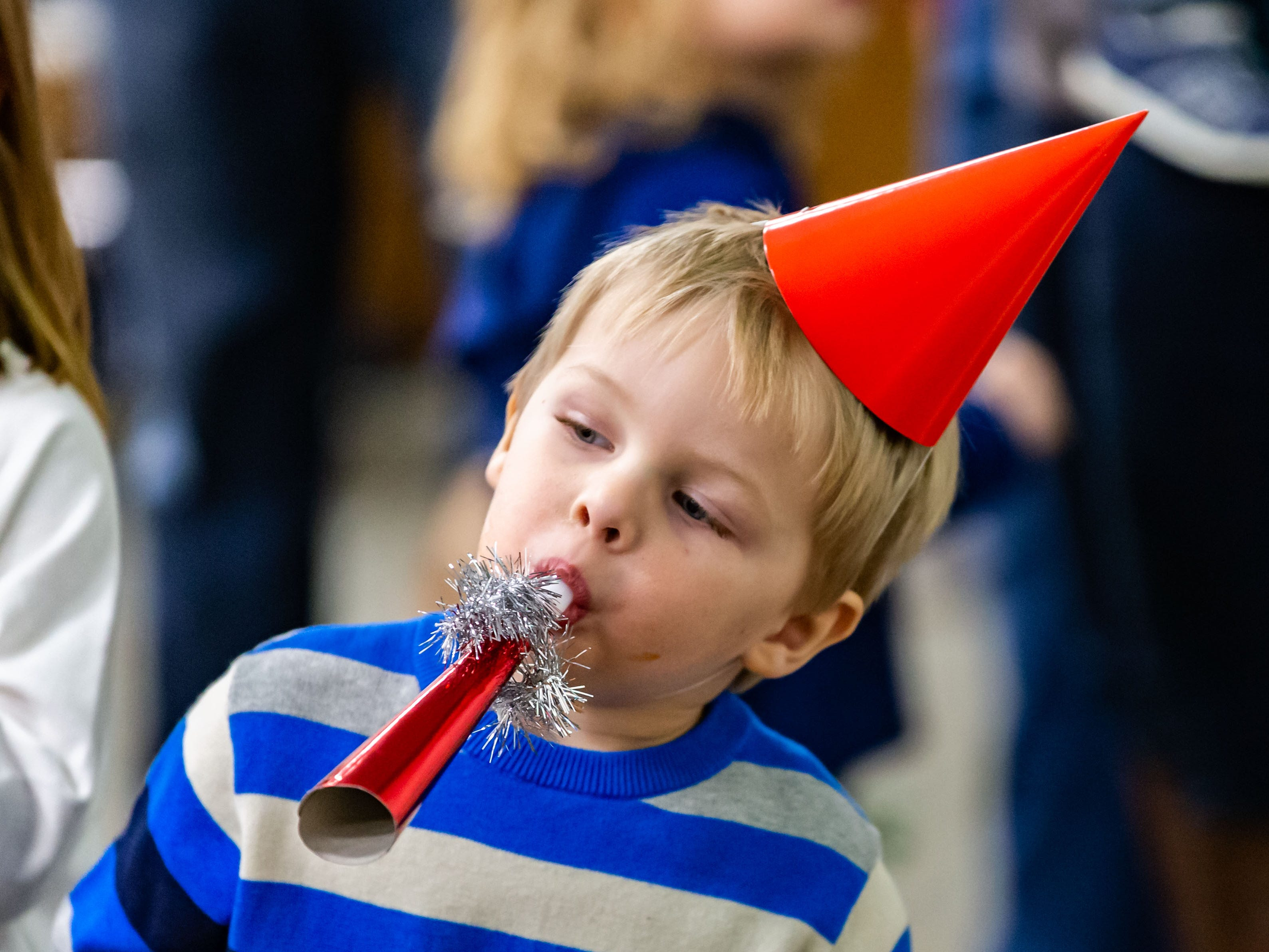 "Three-year-old Elijah Ponsegrau of Mukwonago blows a horn during the ""Noon Year's Eve"" party at the Mukwonago Community Library on Friday, Dec. 28, 2018. The family friendly event featured crafts, music, dancing and a balloon drop at noon."