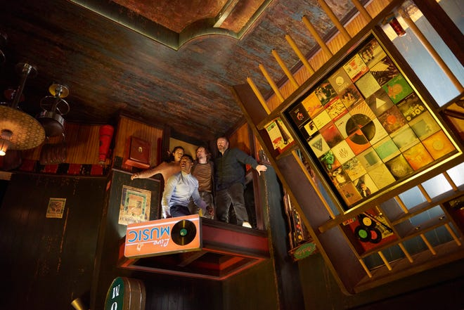 """Jay Ellis, Taylor Russell, Logan Miller and Tyler Labine try to make it out of the upside-down world of """"Escape Room."""""""