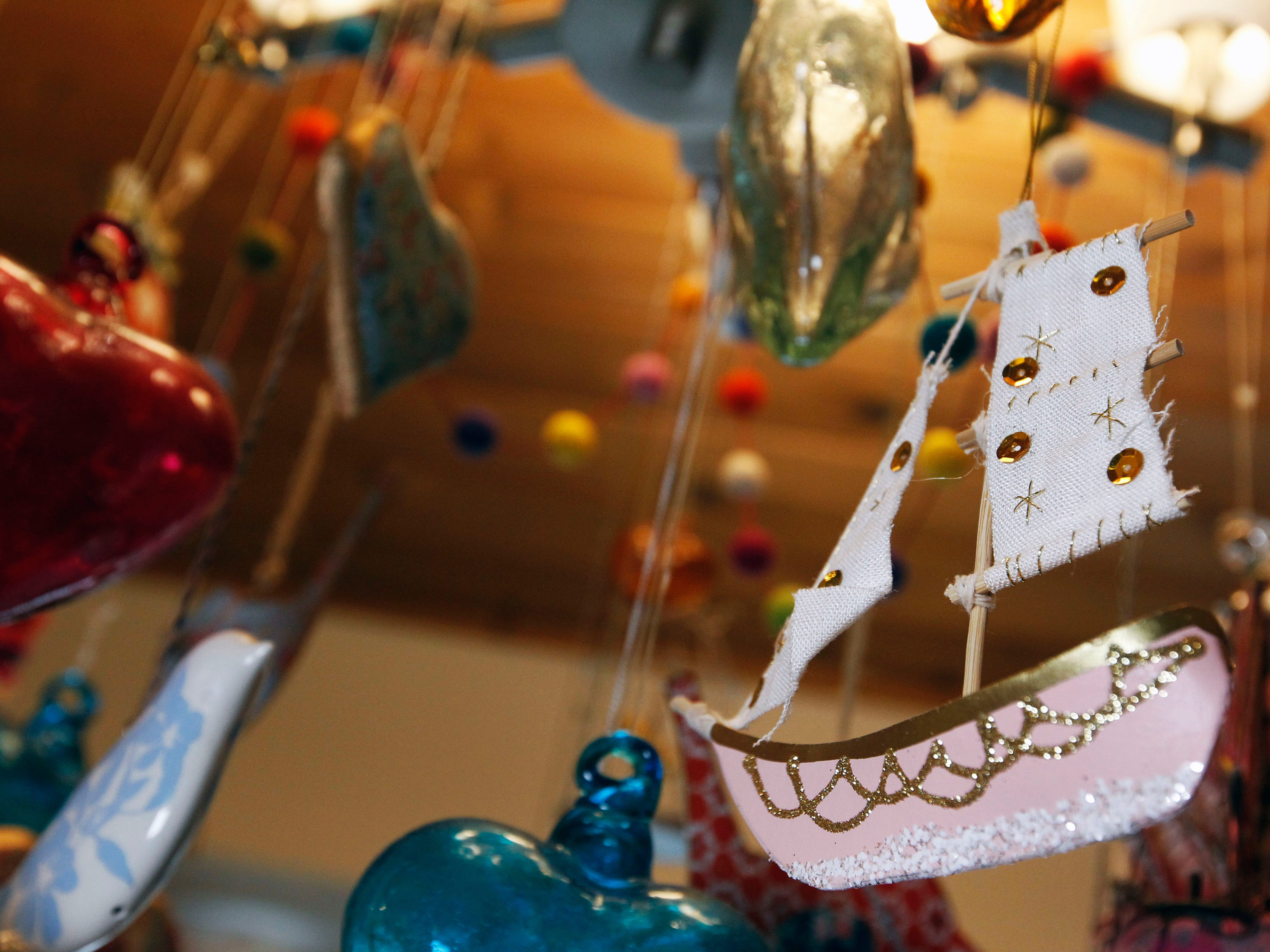 This mobile features original items created by KiKi Johanning, including this ship, a favorite design subject.