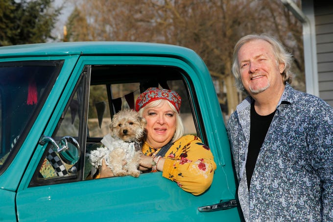 "Vanessa ""KiKi"" and Bob Johanning pose with their pooch, Gypsy Pearl, wearing one of 15 dresses made for her by Kiki, in the couple's 1972 V10 Chevy truck."
