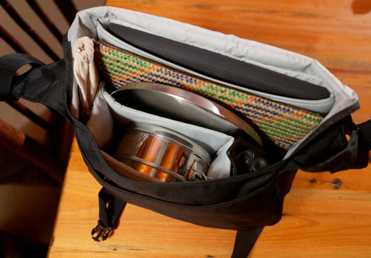 Sure, it carries his laptop, but Ken Leinbach's special satchel also contains reusable servingware that let him avoid plastics for eating at work or in restaurants.