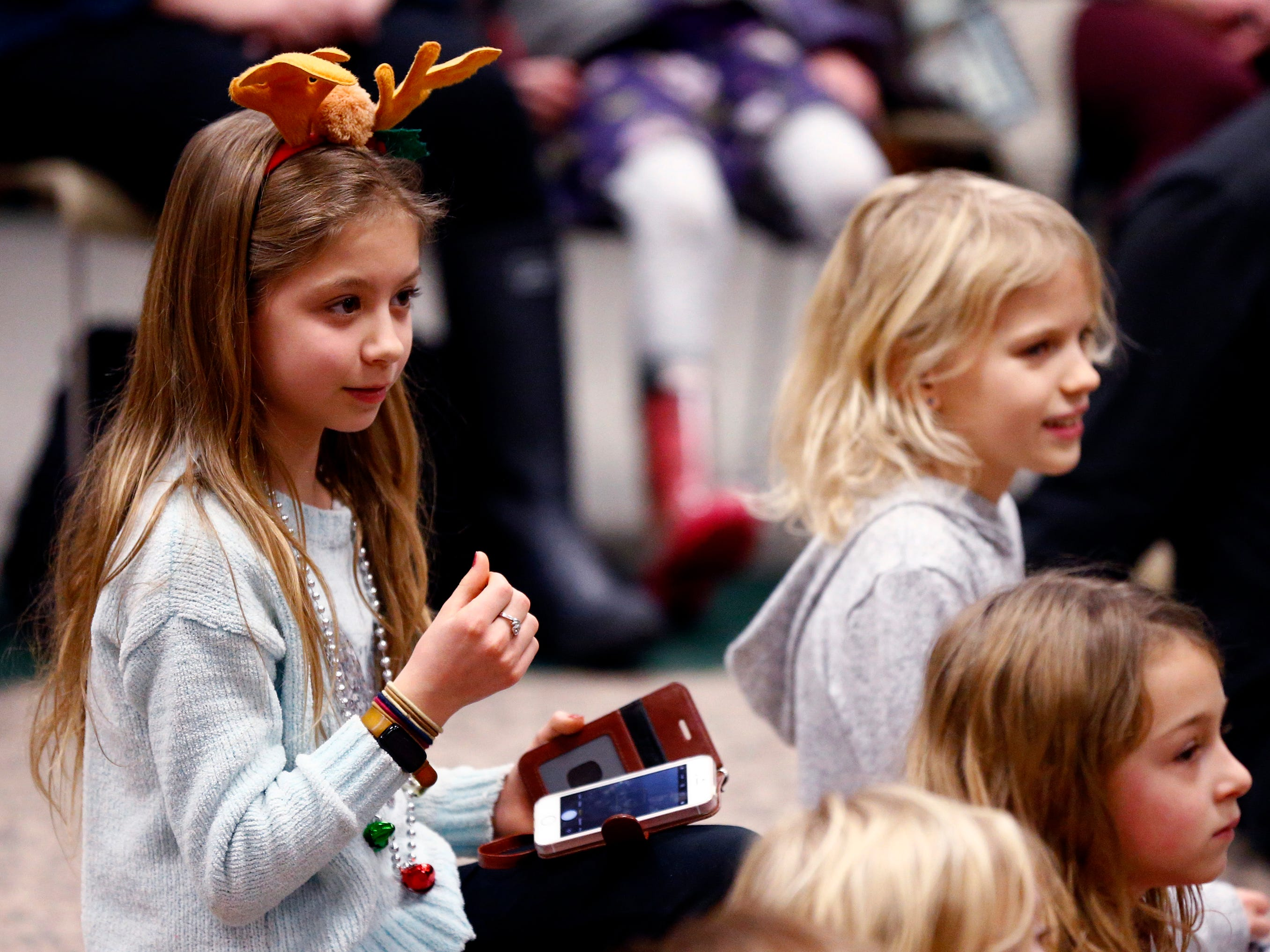 "Children listen to Duke Otherwise and a band he recruited for the song ""What Kind of Hairdo Do You Do?"" during a family performance at the Brookfield Public Library on Dec. 27."