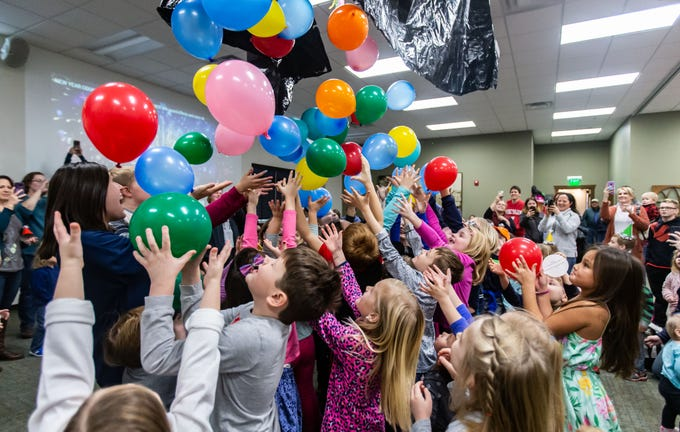 "Youngsters gather round for the balloon drop during the ""Noon Year's Eve"" party at the Mukwonago Community Library on Friday, Dec. 28, 2018."