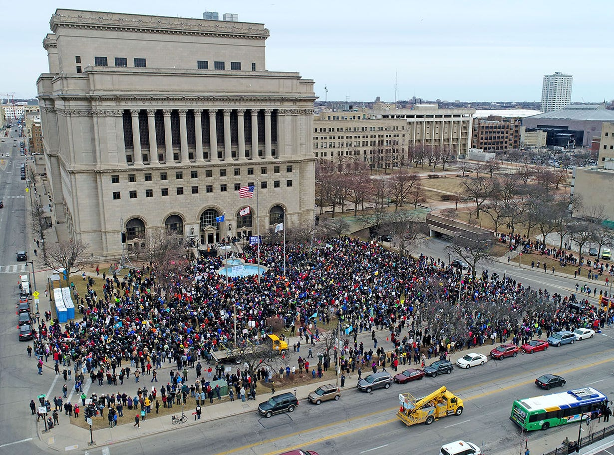 People gather in front of the Milwaukee County Courthouse before marching during the March For Our Lives event in Milwaukee on March 24. Marches in Milwaukee and across the country took place as part of pressure for gun measures following the Parkland shootings.