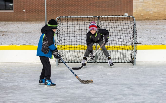 Ten-year-old Nolan Weltzin (right) of Sussex faces off against his brother Nathan, 7, at the Sussex Civic Center ice rink on Sunday, Dec. 30, 2018. The rink is open seven days a week as weather permits. For hours and info visit villagesussex.org.