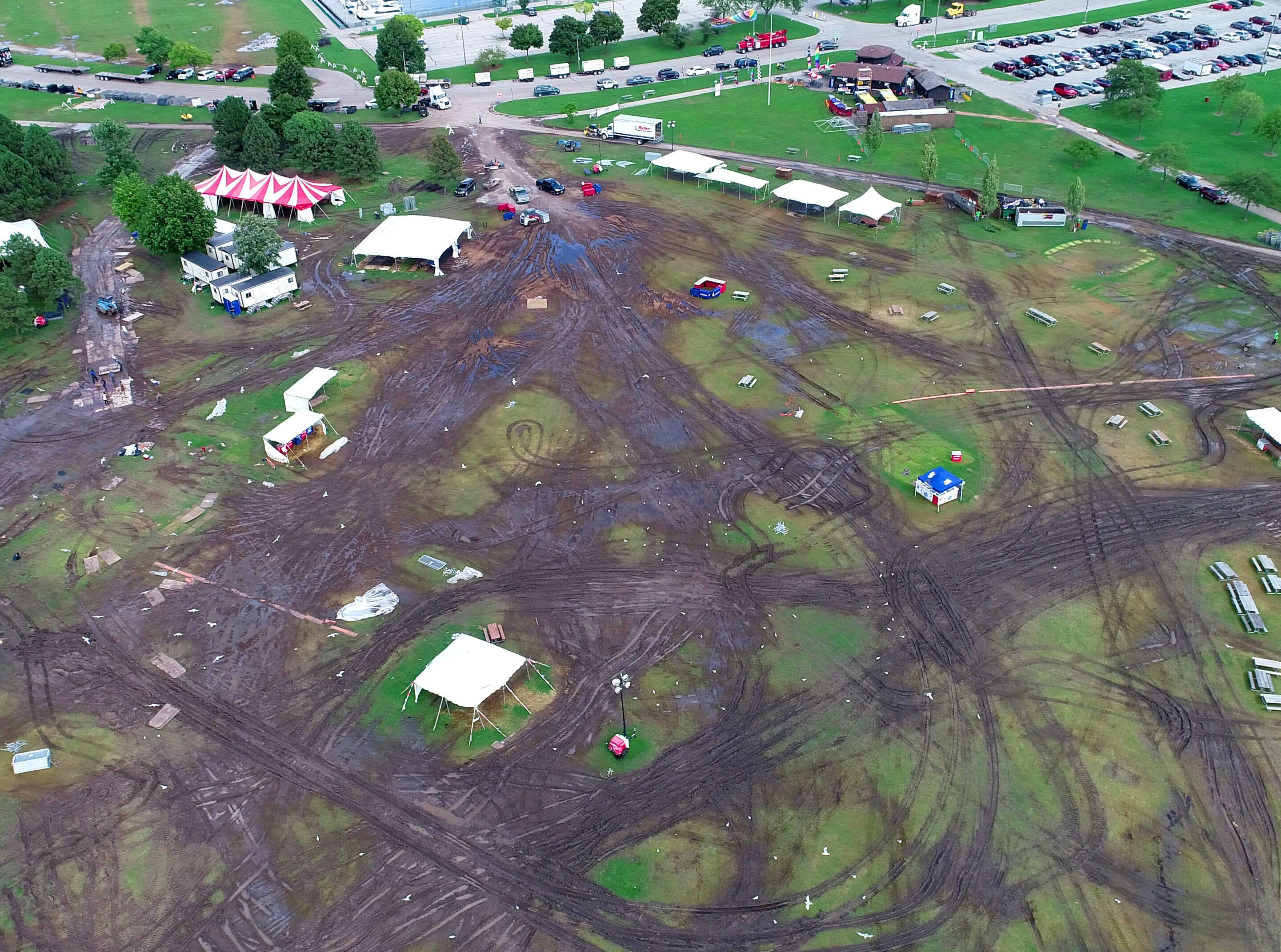 A field of mud and deep ruts can be seen at Veterans Park due to a combination of heavy rain over several days and a flood of party-goers in the city for Harley-Davidson's 115th anniversary celebration.