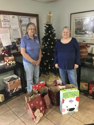 The Mountain Elks Lodge #1714 purchased 21 Christmas Wishes for veterans that are residing in nursing homes, and also donated to The Christmas Wish Foundation of Mountain Home, which is dedicated to helping children have a better Christmas. Shown are Past Elks president Patty Underwood (left) and Elks Member Cathy Underwood.