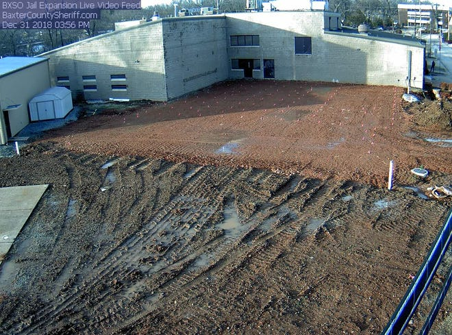 Fresh dirt work shows the rough size of the planned 50-bed expansion to the Baxter County Detention Facility in this Dec. 31 photo taken from a live video feed monitoring construction at the site. A 0.25-percent sales tax to support the expanded jail began being collected by merchants today.