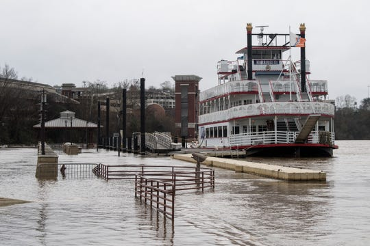 Water levels rise flooding the Riverfront Park in Montgomery, Ala., on Monday, Dec. 31, 2018. Following a wet weekend the rain is projected to continue throughout the week.