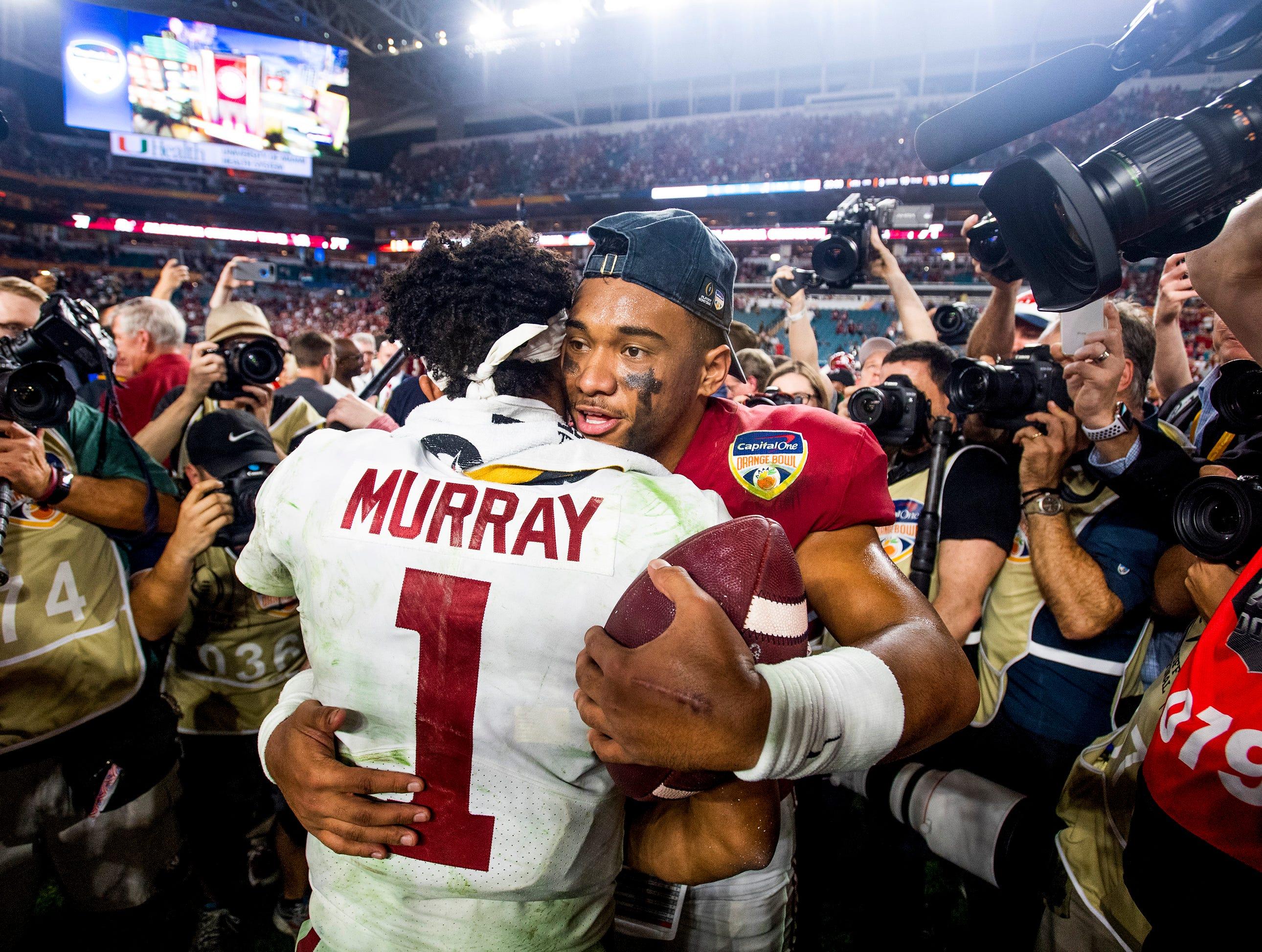 Alabama quarterback Tua Tagovailoa (13) hugs and talks with Oklahoma quarterback Kyler Murray (1) after Alabama defeated Oklahoma in the Orange Bowl at Hard Rock Stadium in Miami Gardens, Fla., on Saturday December 29, 2018.