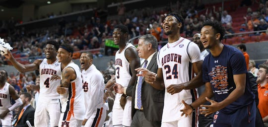 Auburn head coach Bruce Pearl and his players react during the final seconds of their win over North Florida on Dec. 29, 2018, in Auburn, Ala.