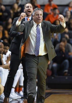 Auburn head coach Bruce Pearl cheers after a score against North Florida on Saturday, Dec. 29, 2018, in Auburn, Ala.