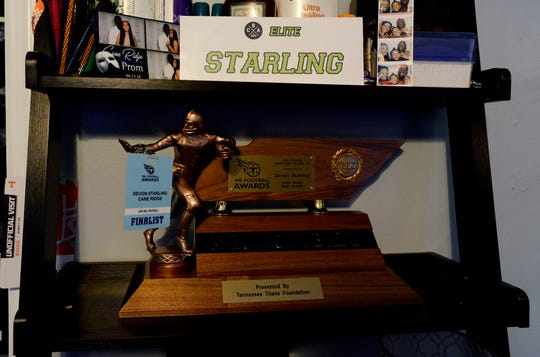 The Mr. Football trophy rests on a shelf in Devon Starling's bedroom.
