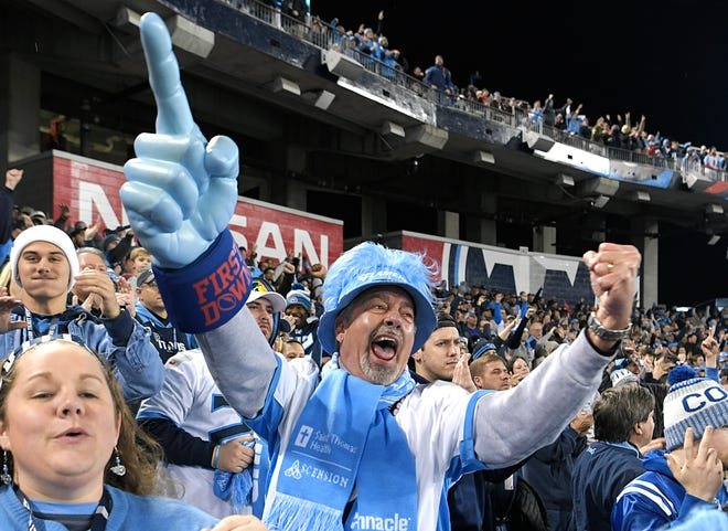 Ttians fan Ward Phillips of Waverly cheers after the Titans score against the Colts at Nissan Stadium Sunday, Dec. 30, 2018, in Nashville, Tenn.