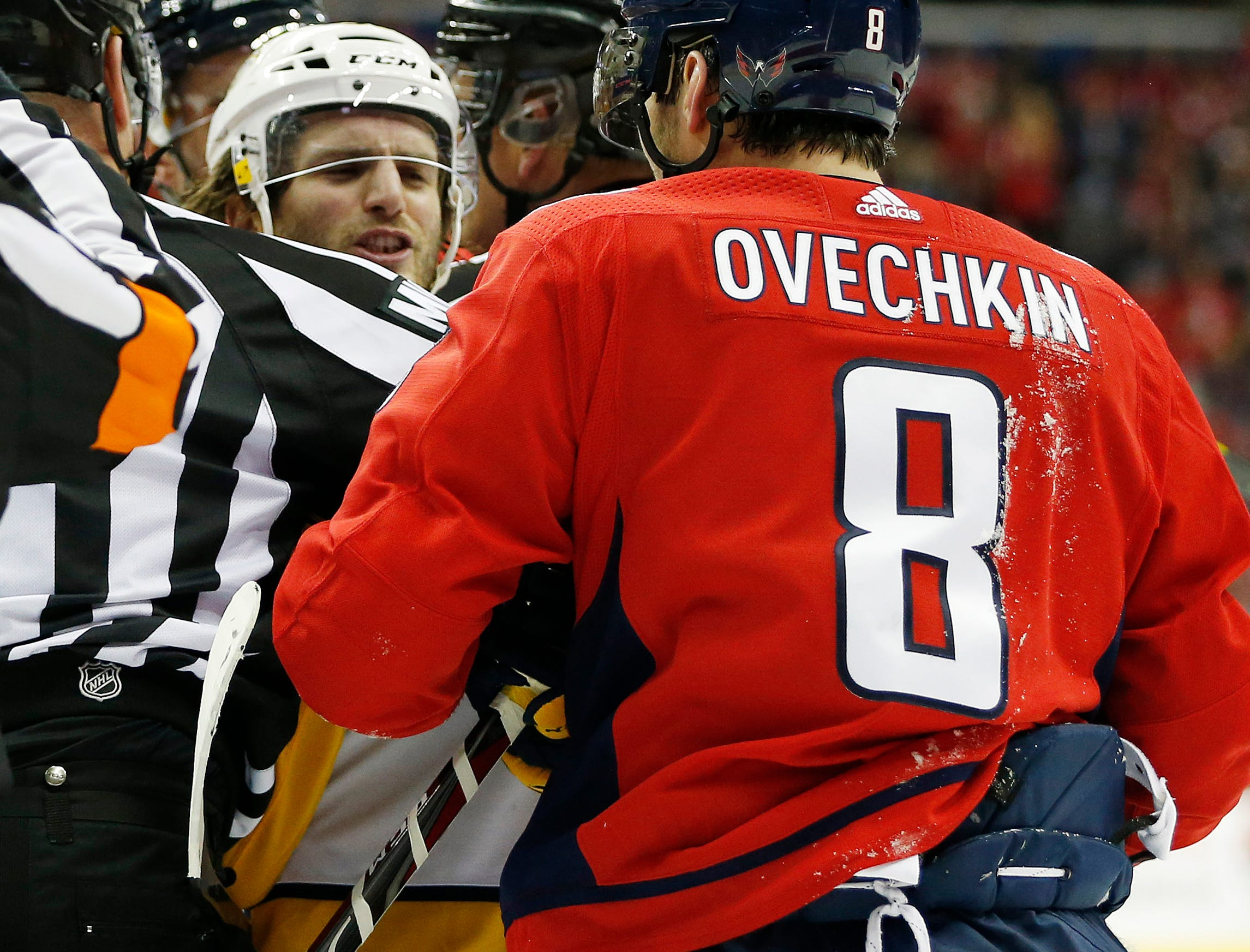 Washington Capitals left wing Alex Ovechkin (8) exchanges words with Nashville Predators right wing Ryan Hartman (38) during the third period at Capital One Arena.