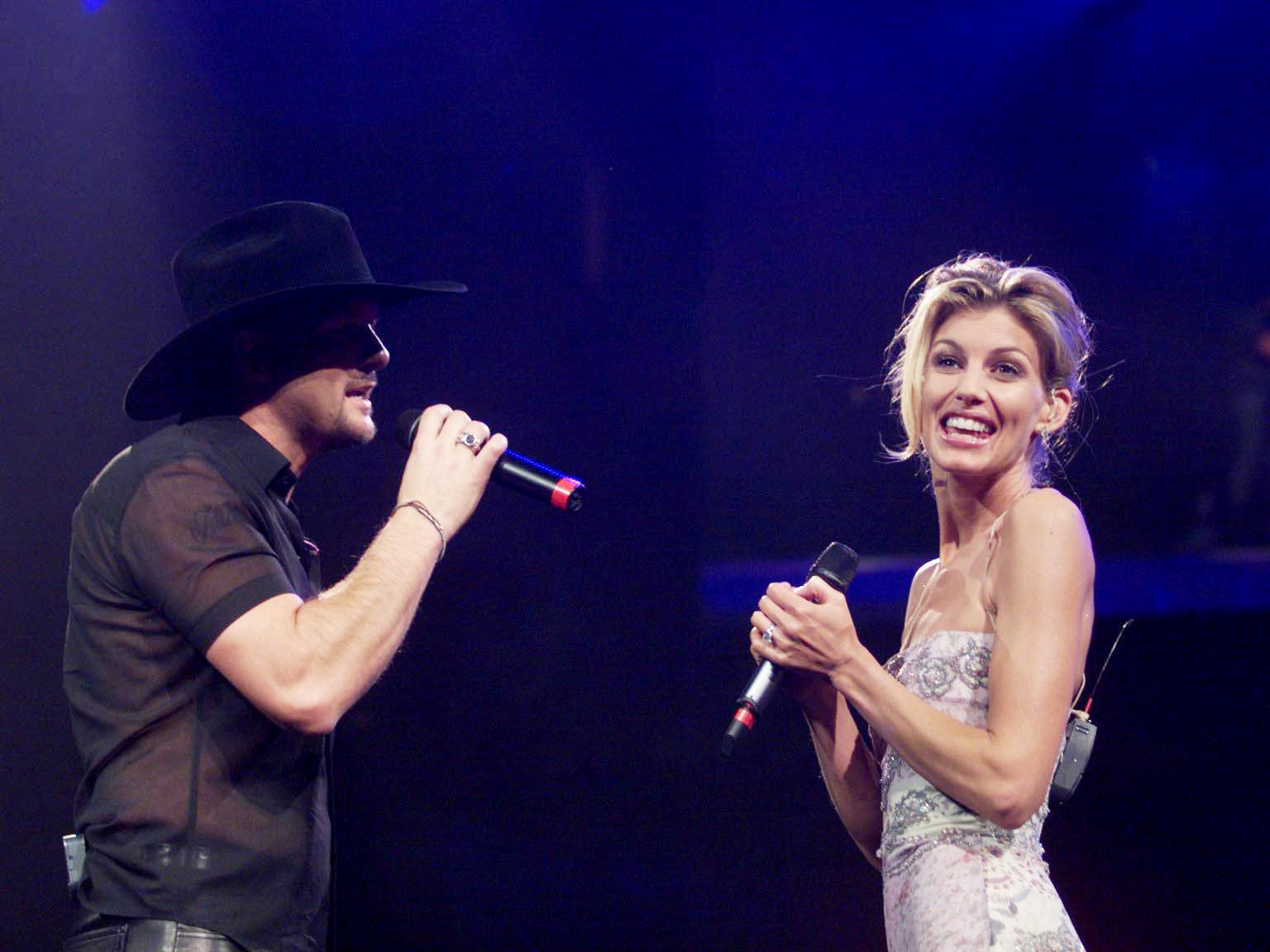 Tim McGraw sings to his wife, Faith Hill during their New Year's Eve concert at the GEC Dec. 31, 1999.