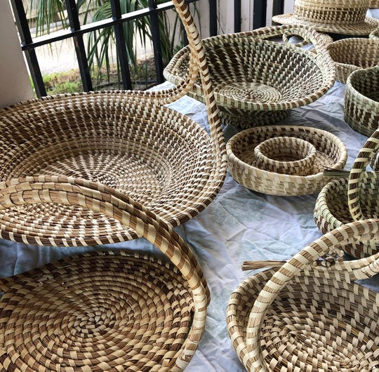 Traditional sweetgrass basket weaving is a common sight at the Charleston City Market.