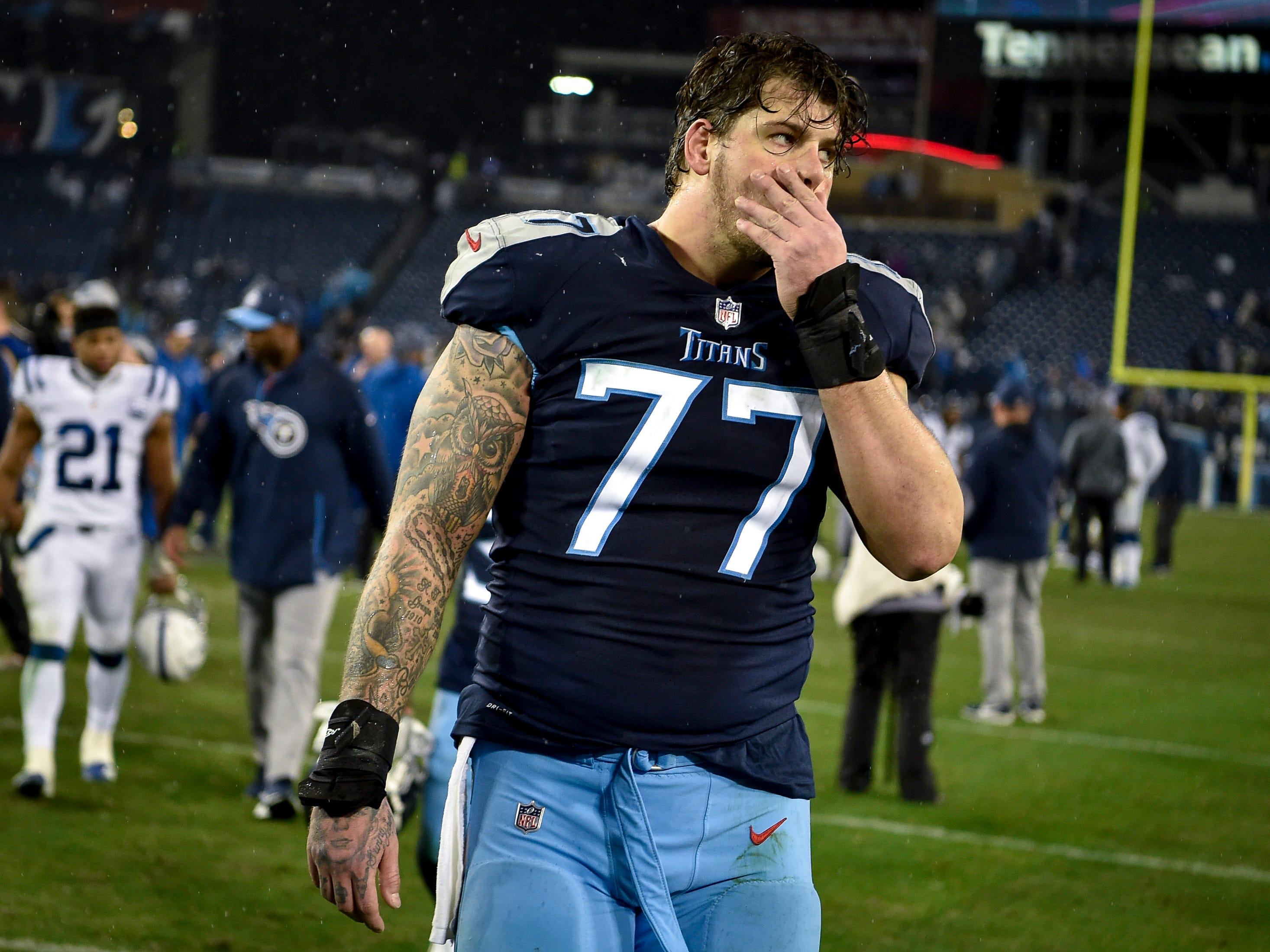 Tennessee Titans offensive tackle Taylor Lewan (77) walks off the field after their loss to the Indianapolis Colts at Nissan Stadium in Nashville, Tenn., Sunday, Dec. 30, 2018.