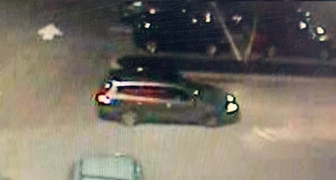 The suspects' vehicle, which police say is a gray Infiniti SUV.