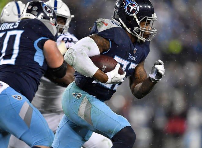 Titans running back Derrick Henry (22) gains yards in the third quarter at Nissan Stadium Sunday, Dec. 30, 2018, in Nashville, Tenn.