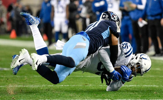 Titans safety Kevin Byard (31) brings down Colts tight end Eric Ebron (85) in the first quarter at Nissan Stadium Sunday, Dec. 30, 2018, in Nashville, Tenn.
