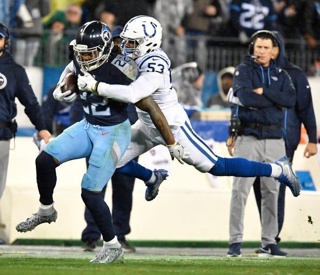 Colts linebacker Darius Leonard (53) tries to bring down Titans running back Derrick Henry (22) in the third quarter Sunday.