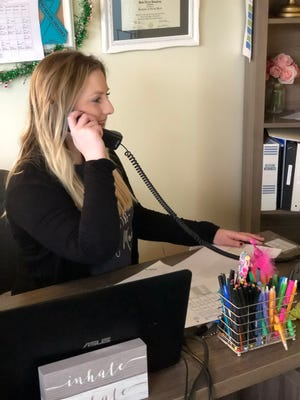 Project HELP counselor Kate Humphrey answering and assisting a victim on the helpline.