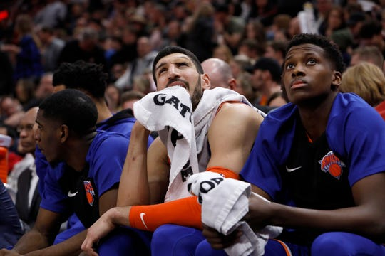 New York Knicks' Enes Kanter, center, reacts as his team trails behind the Utah Jazz late in the second half of an NBA basketball game on Saturday, Dec. 29, 2018, in Salt Lake City.