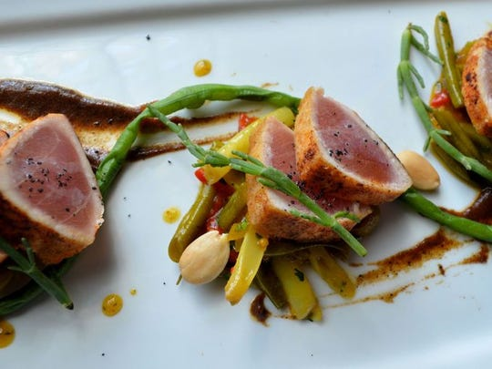 Striped Marlin a la plancha with four- bean salad, Marcona almonds and charred Vidalia onion at The Frog and The Peach.