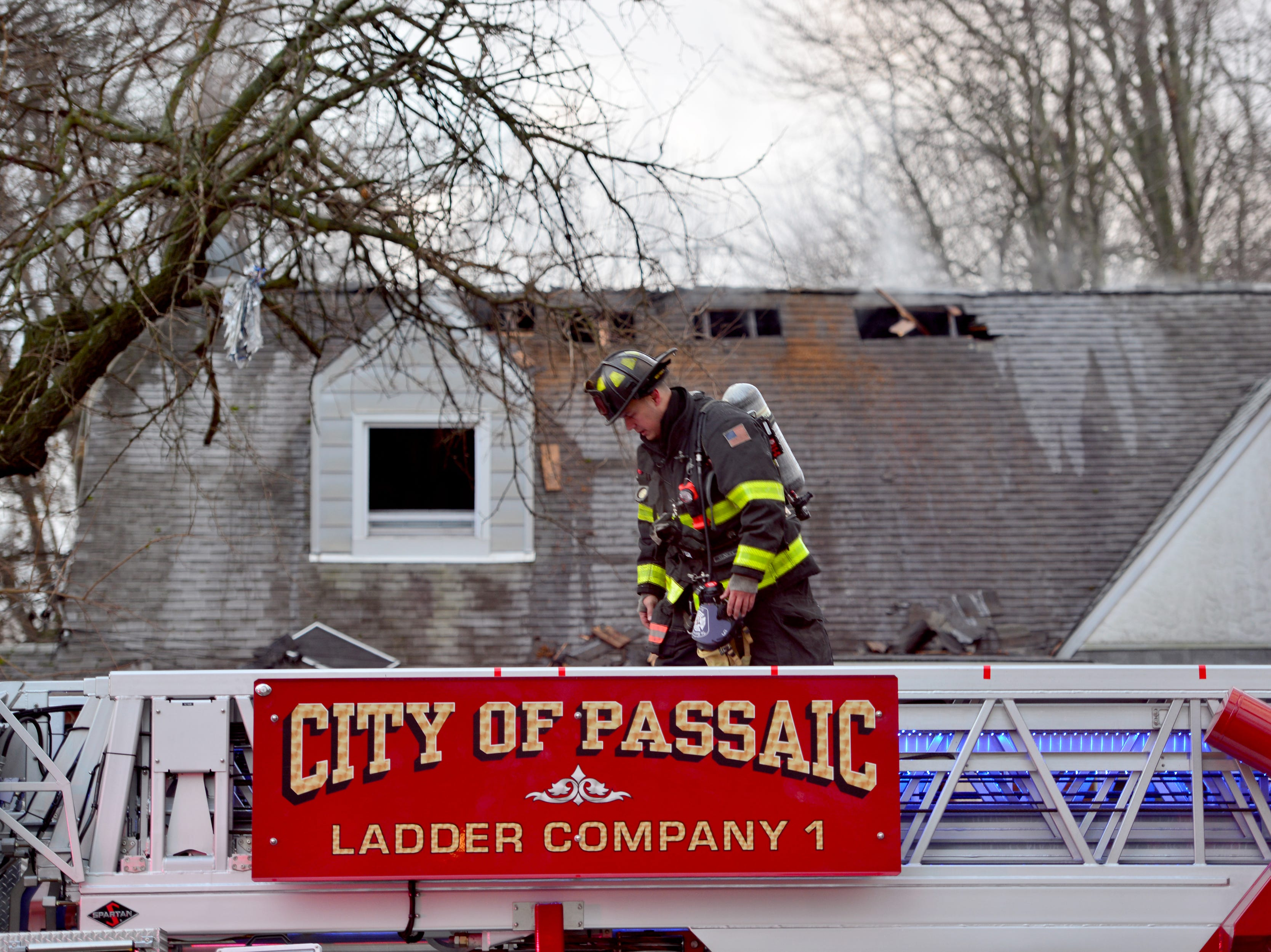 A volunteer Rutherford firefighter saw smoke coming from out a house as he was driving to work on Union Ave and went to investigate, but saw nobody at the scene in Passaic, on Monday December 31, 2018. He called 911 ands began banging on the front door of the house to wake up the residents who were sleeping as the attic was on fire according to Passaic Deputy Fire Chief Kevin Burgos. No injuries were reported to the three residents in the house or firefighters.