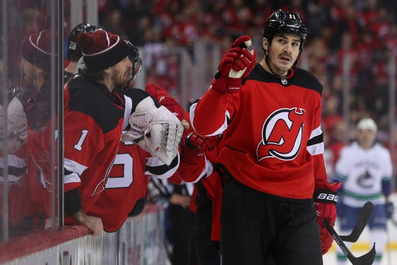 Dec 31, 2018; Newark, NJ, USA; New Jersey Devils center Brian Boyle (11) points to the stands after a scoring a goal during the first period of their game against the Vancouver Canucks at Prudential Center.