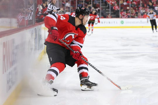 Dec 31, 2018; Newark, NJ, USA; New Jersey Devils left wing Miles Wood (44) skates with the puck during the second period of their game against the Vancouver Canucks at Prudential Center.