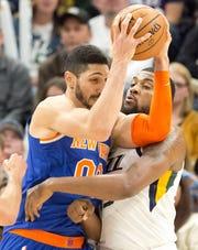 Dec 29, 2018; Salt Lake City, UT, USA; Utah Jazz forward Derrick Favors (15) defends against New York Knicks center Enes Kanter (00) during the second half at Vivint Smart Home Arena.