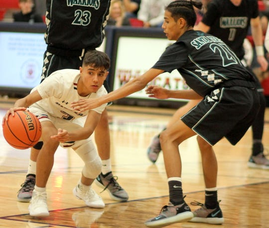 Junior Wildcat Ramiro Saenz (with ball) plays a key role at the point position.