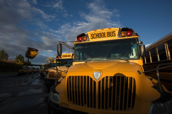 School buses in a yard in Las Cruces.