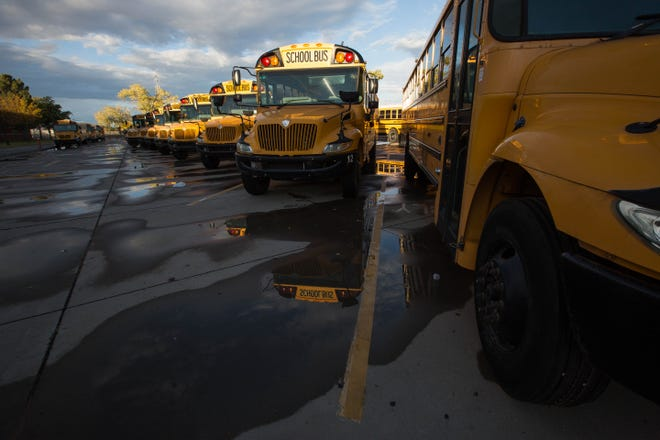 School buses parked at a satellite parking facility at Oñate High School on October 31, 2018.