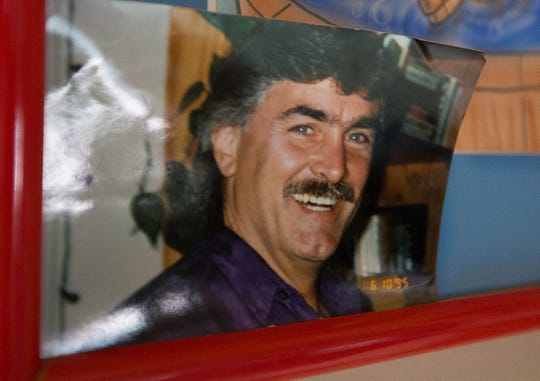 A 1995 photo of Steven Leask on display at the Las Cruces home he shared with his wife. Since his death in 2016, his widow, Libby Leask, has been unable to access his pension.