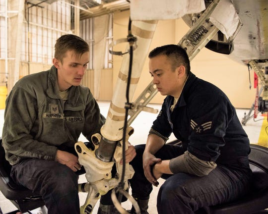 (From left to right) Staff Sgt. Austin Humphres, 849th Aircraft Maintenance Squadron dedicated crew chief, and Senior Airman Jordan Eveland, 314th Aircraft Maintenance Unit DCC, perform maintenance on an F-16 Fighting Falcon Oct. 18 on Holloman Air Force Base, N.M. As DCCs, Humphres and Eveland are assigned to specific aircraft, and are responsible for all fight essential maintenance on their aircraft.