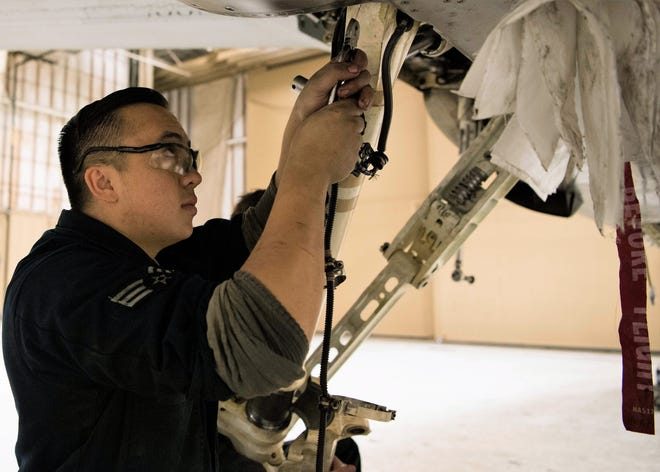 Senior Airman Jordan Eveland, 314th Aircraft Maintenance Unit dedicated crew chief, performs maintenance on an F-16 Fighting Falcon Oct. 18 on Holloman Air Force Base, N.M. As a DCC Eveland is assigned to a specific aircraft, and is responsible for all fight essential maintenance on his aircraft.