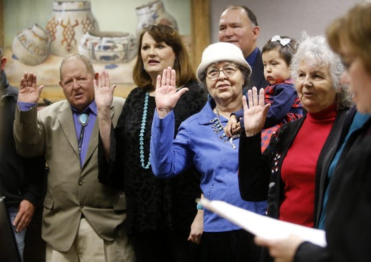 County Commissioner Michael Sullivan, left, Probate Judge Stacey Biel, County Commissioner GloJean Todacheene and Public Education Commissioner Georgina Davis take the oath of office Monday at the County Commission chambers in Aztec.