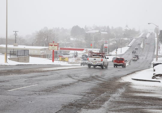 Traffic moves along 20th Street in Farmington on Monday.