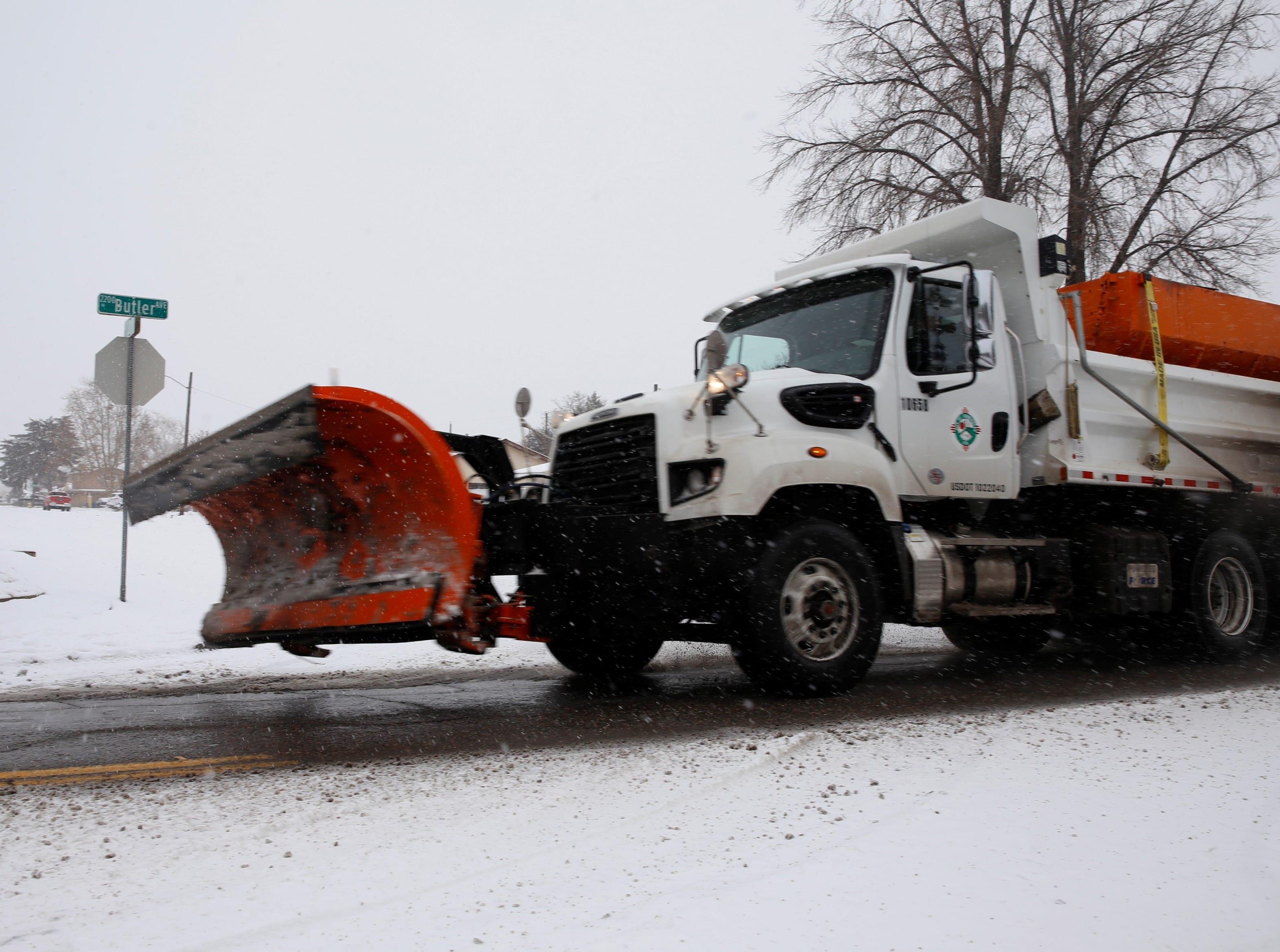 A city of Farmington snow plow travels near the 2200 block of Butler Avenue on Monday in Farmington.