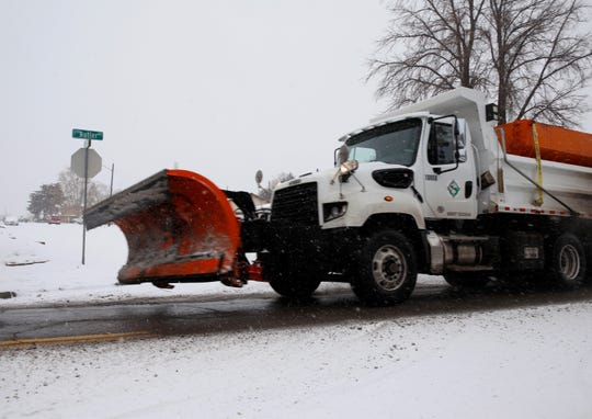 A city of Farmington snow plow travels near the 2200 block of Butler Avenue on Monday in Farmington.